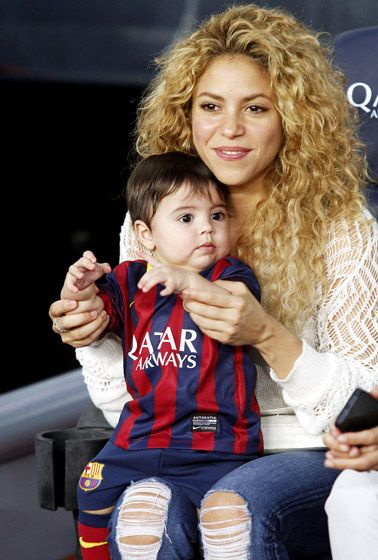 Shakira and baby boy Milan cheered on FC Barcelona player Gerard Pique — Shakira's beau and Milan's papa — during a soccer match in Barcelona.