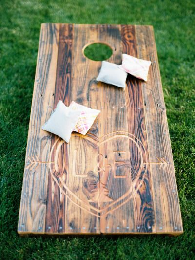Wedding Lawn Game: Cornhole - Boards can be carved with the wedding monogram. Bags can be sewn from fabric in the wedding colors.
