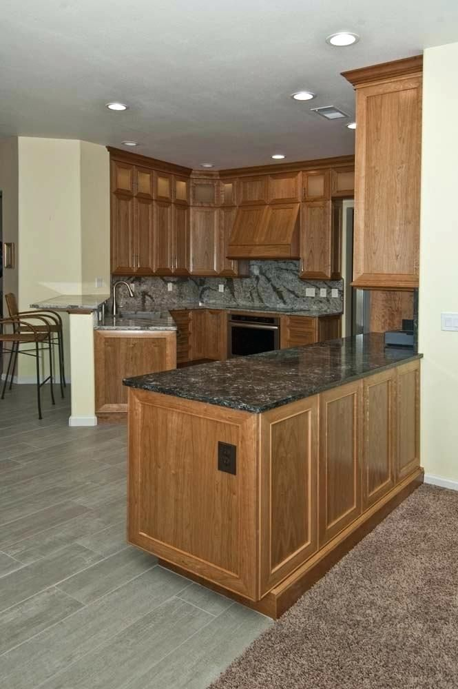Natural Cherry Cabinetry Wood Cabinets With Gray Floors Kitchen