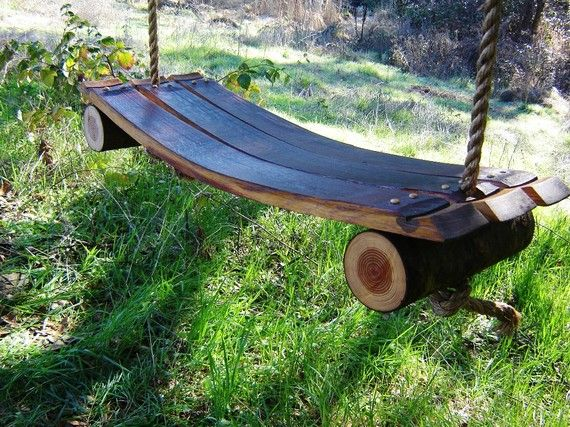 Etsy seller CoolHollowFarms -- swing made from wine barrel and fallen tree