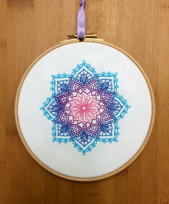 Colours can be personalised - just ask  Mandala ~ Indian embroidery hoop art - pink centre radiating out through lilac purple to turquoise on white heavy cotton drill. Finished with a lilac hanging ribbon  Machine embroidered using quality rayon colourfast thread on 100% cotton drill, framed under tension in a 7 British made beech embroidery hoop, the back is enclosed with felt to cover embroidery and also protect your wall from any marks. Thanks for looking and please free to ask any…