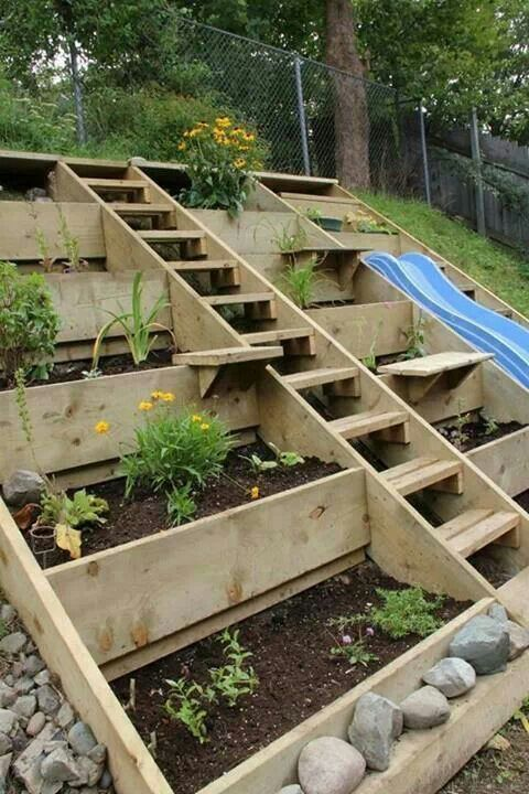 steep garden boxed up with access stairway made of timber