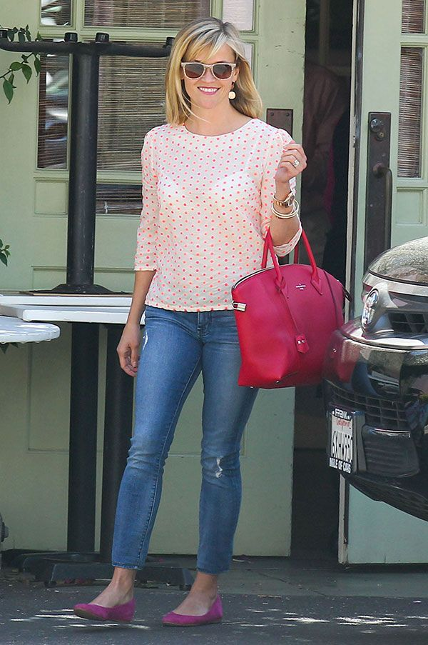 Reese Witherspoon's style is feminine and sweet in this grown-up version of cute polka dots. Click for more of her great looks. #reesewitherspoon #styleguide #polkadots