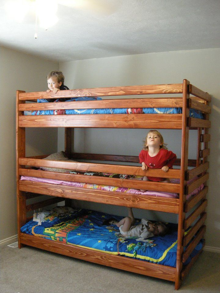 FREE shipping! Triple bunk bed built using plans from Bunk Beds Unlimited showing that there is plenty of room for children in each level.