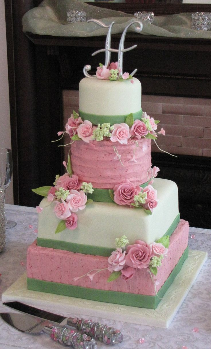 Buttercream and fondant both.  This is well done.  Looks stunning, and would have been able to be assembled at the last minute, to avoid the fondant sweating from the BC.  Also very pretty!  ;)