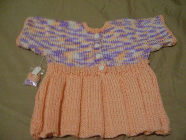Baby girls dress, orange, hand knitted, original design, 6-12 months acrylic | Shop this product here: http://spreesy.com/LittleKiwiKnits/2 | Shop all of our products at http://spreesy.com/LittleKiwiKnits    | Pinterest selling powered by Spreesy.com
