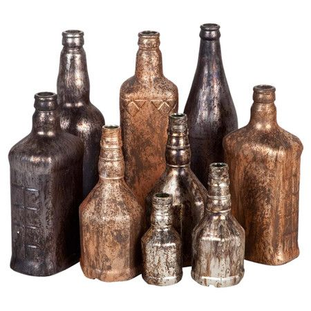 Revamp recycled bottles with Rust-Oleum Universal metallics - See more at: http://www.home-dzine.co.za/crafts/craft-classy-glass.htm#sthash.YILGSaqj.TVFwWBx4.dpuf  Rust-Oleum Universal titanium silver and aged copper spray paint