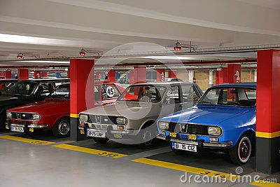 1300 Dacia cars in underground parking at vintage cars parade in Bucharest, Romania.