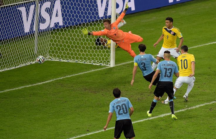 This World Cup Wonder Goal Needs To Be Seen Again And Again - James Rodriguez of Colombia scores his team's second goal and his second of the game past goalkeeper Fernando Muslera of Uruguay during the 2014 FIFA World Cup Brazil round of 16 match between Colombia and Uruguay at Maracana on June 28, 2014 in Rio de Janeiro,