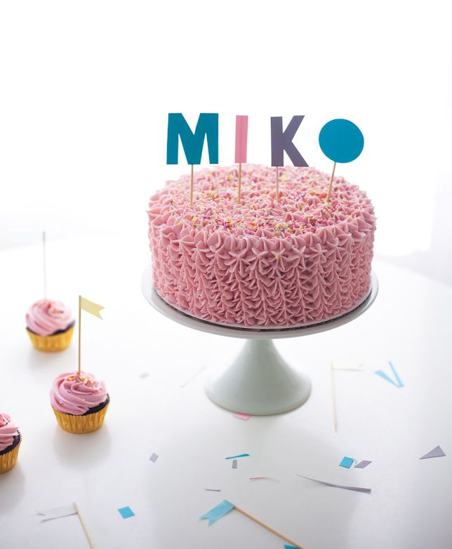 pink ruffle birthday cake with typographic cake topper - coco cake land