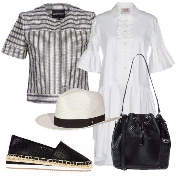 La giacca bianca e nera a a maniche corte evidenzia i dettagli dell'abito bianco con rouches modello chemisier . Le espadrillas nere di pelle traforata, la borsa a spalla con lo stesso motivo ed il cappello panama completano il look.