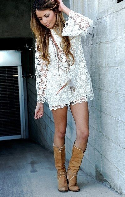White lace dress and brown suede cowboy boots.