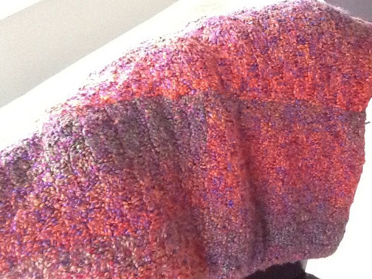 knitted throw.  basketweave pattern.  large squares sown together.