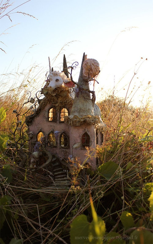 That is one whimsical looking...dollhouse?