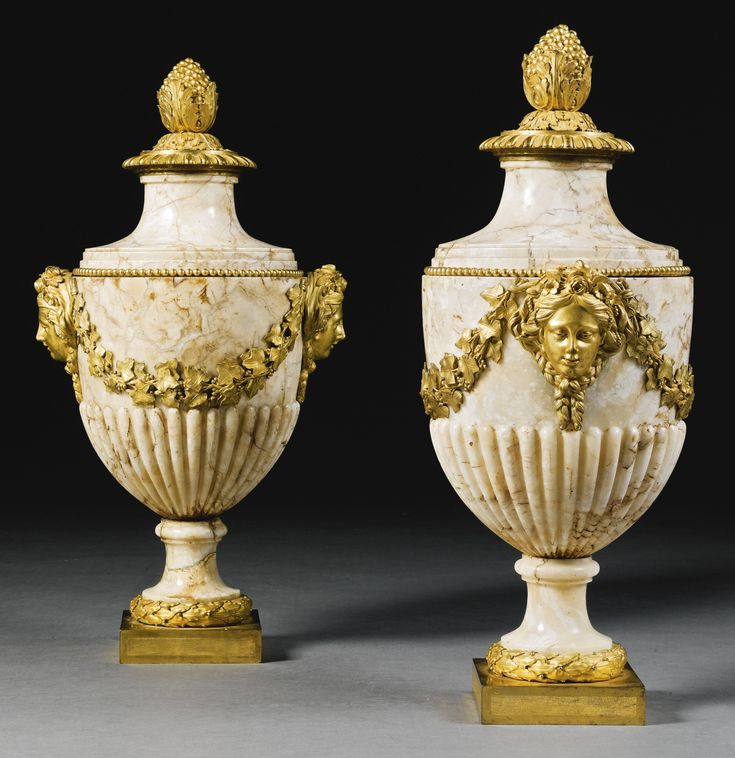 A pair of gilt-bronze mounted mottled brown marble lidded urns Louis XVI, circa 1775, the mounts attributed to Pierre Gouthière | Lot | Sotheby's