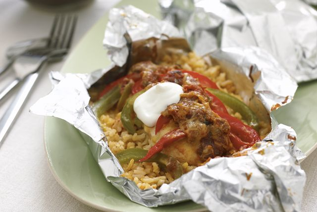 foil-pack-chicken-fajita-dinner-111262 Image 1 - From chicken breasts to peppers, salsa and shredded cheese, this delectable dish has it all—in a foil pack that's easy on the cleanup crew!