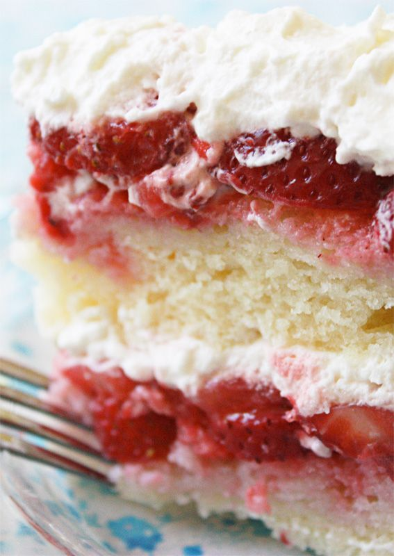 Strawberry Cake recipe from JennyCanCook.com A show-stopping cake made with 2 lbs of fresh berries and covered with whipped cream. Wow!!