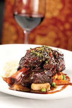 Red Wine Braised Lamb Shank over a creamy cheesy Risotto topped with a Parsley Gremolata .