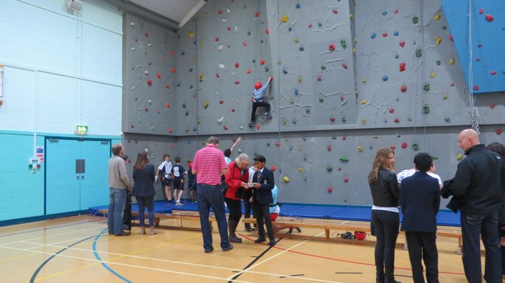 Visitors were able to have a go on the climbing wall, belayed by members of the school's climbing club.
