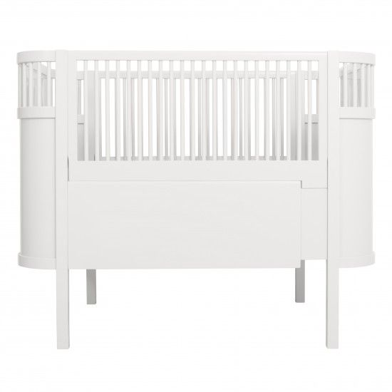 Kili baby & jr. bed, white Description  Art no: 2084  Super stylish and popular baby / junior Kili bed, suitable for children from birth to about 7 years of age. The bed is beautifully made from birch and spray-painted with non-toxic paint. It comes with 2 side pieces, so it is easy to change the bed from a cot to a junior bed.  Material Birch wood  Measurements L110cm W70cm H90,5cm (L150cm) RRP 799.00EUR Kili baby & jr. bed, white