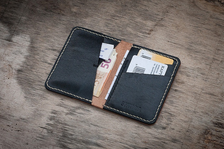 Leather bifold wallet natural veg tan and black. $40.00, via Etsy.