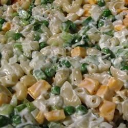 Pasta salad with peas and cheese. Cooked macaroni takes on a comforting blend of sour cream, mayonnaise and Cheddar cheese. Sweet pickle relish and tender green peas add color and flavor. This simple pasta salad is best served after a good, long chill in the fridge.