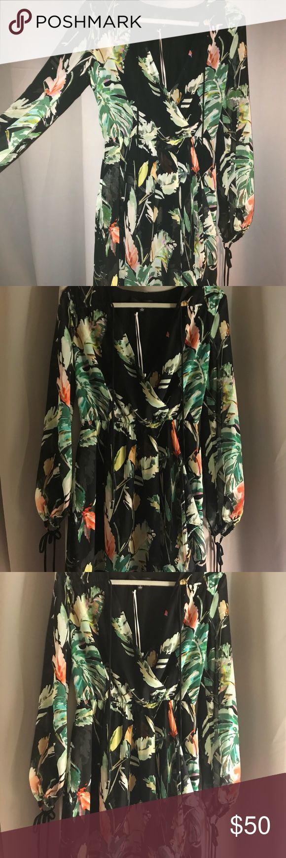Gorgeous floral long sleeve dress. Brand new! Brand new with tags! Bought at a boutique in Encinitas, CA and just didn't fit. Never been worn. Perfect dress for a vacation :) Adelyn Rae Dresses Long Sleeve