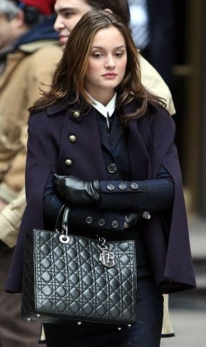 Expensive-looking navy wool coat with a little detail, leather gloves and a perfect classic bag...