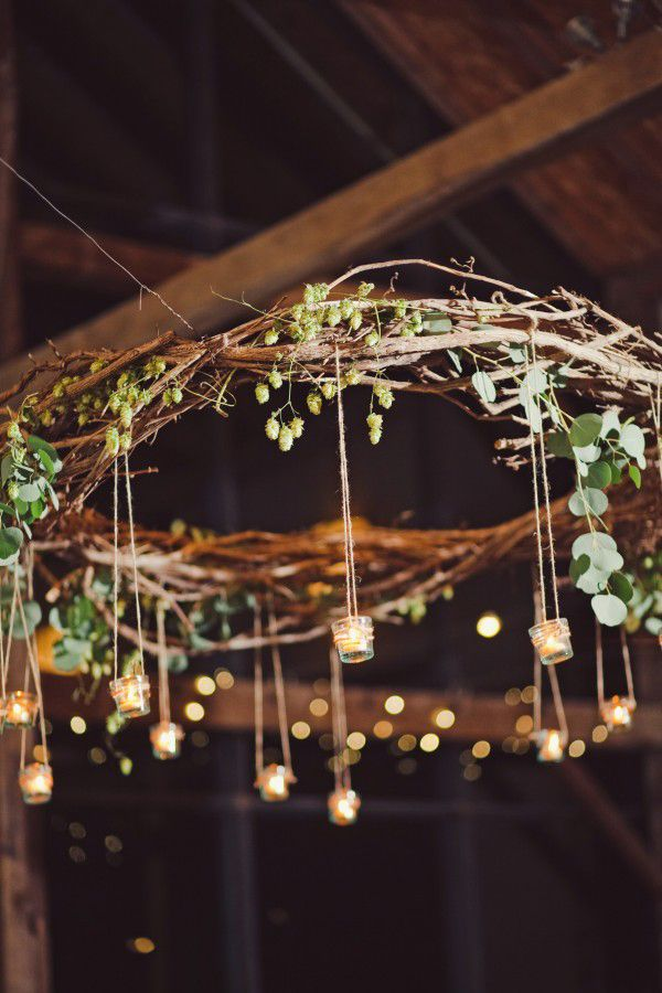 Want an extra special touch for your fairy-tale wedding?  This woodsy chandelier features votives dangling overhead (but maybe use flameless candles in order to prevent wax from dripping on unsuspecting wedding guests).
