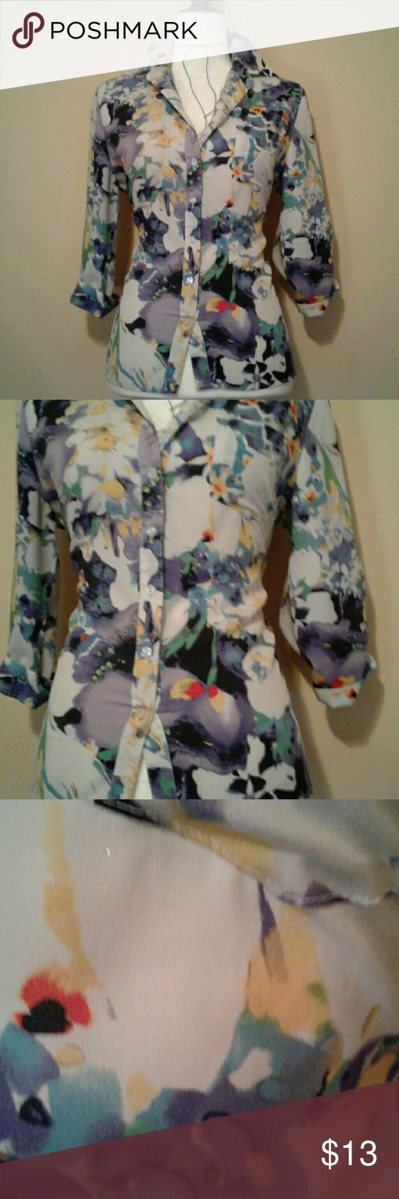 New York Sere Bade floral hig low Blouse New York Sere Bade floral hig low Blouse   Super stylish and cute   100%polyester   High & low  Blouse   Great condition   Size Medium New York & Company Tops Button Down Shirts