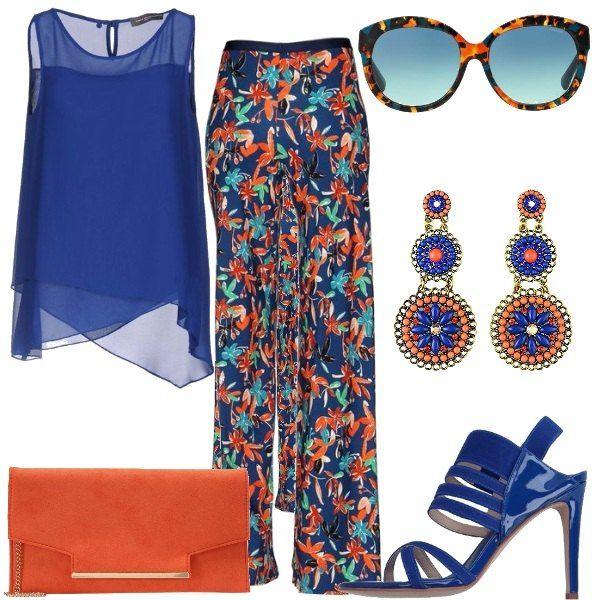 Pantaloni protagonisti in questo outfit, modello che scende largo sulla gamba di colore blu, con una fantasia floreale. Ho abbinato una blusa leggera con orlo asimmetrico. I sandali in vernice blu hanno un tacco alto che slancia la figura, la borsa è una pochette arancione molto semplice. Gli orecchini richiamano i colori dell' outfit, blu e arancione. Gli occhiali da sole sono l'accessorio estivo che non deve mai mancare.