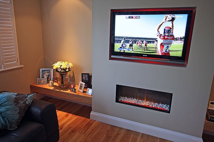 """fireplace with built in TV  accent wall 