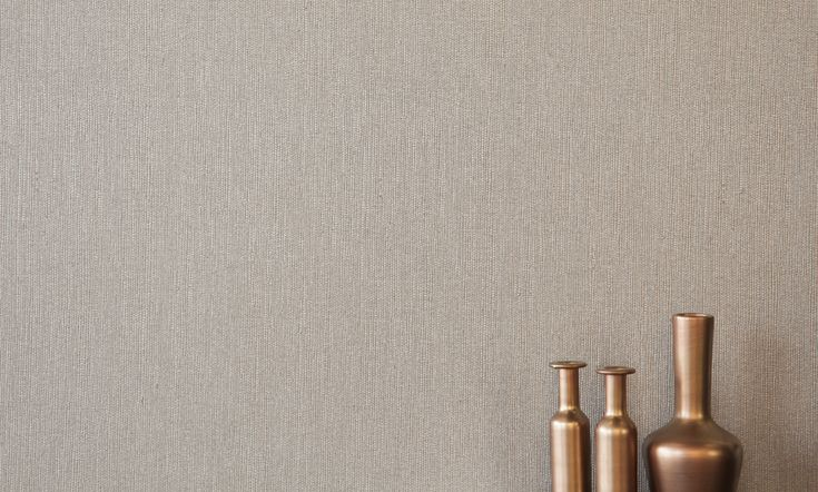 Saigon Pewter is a high performance wallcovering with a subtle grass weave texture.