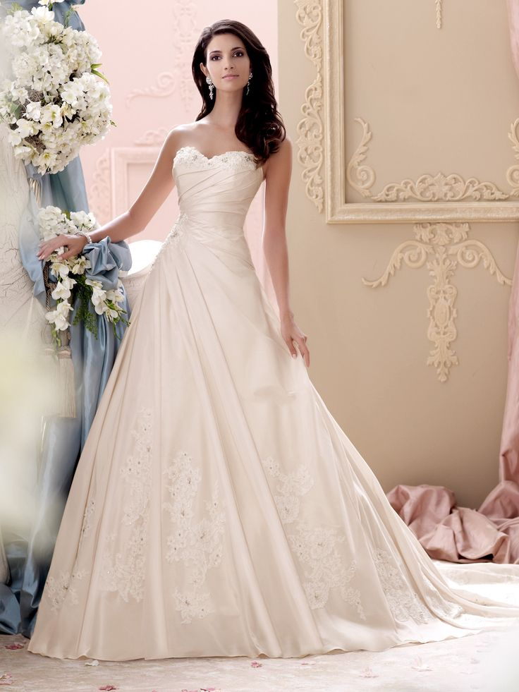 Style 115233, Apple, is a beautiful strapless asymmetrical wedding dress designed by David Tutera for Mon Cheri. Click for more information.