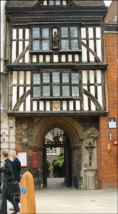 St Bartholomew's gatehouse that leads to the oldest parish church in London - St Bartholomew-the-Great - was built in the sixteenth century and is where Queen Mary ate chicken and drank red wine while watching Protestant martyrs burn at the stake. It was only when a first World War German Zeppelin bomb in 1916 fell nearby that the tiles to this arch fell off to reveal this Elizabethan half timber fronted house built in 1597.    Front and rear view of the Elizabethan gate house