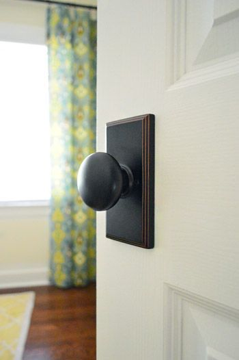 Love this doorknob style - oil bronzed doorknob with rectangle plate