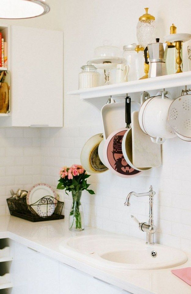 Or screw hooks underneath a shelf to hang cooking basics. | 17 Ways To Squeeze A Little Extra Storage Out Of A Tiny Kitchen