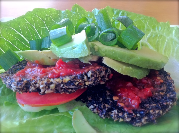 So, he asked for a burger and I complied but of the mushroom variety with seeds and vegetables, gently dehydrated and served in between sheets of cos and pillows of avocado, raw tomato salsa, spring onions and cucumber.......and he said, thank you:)