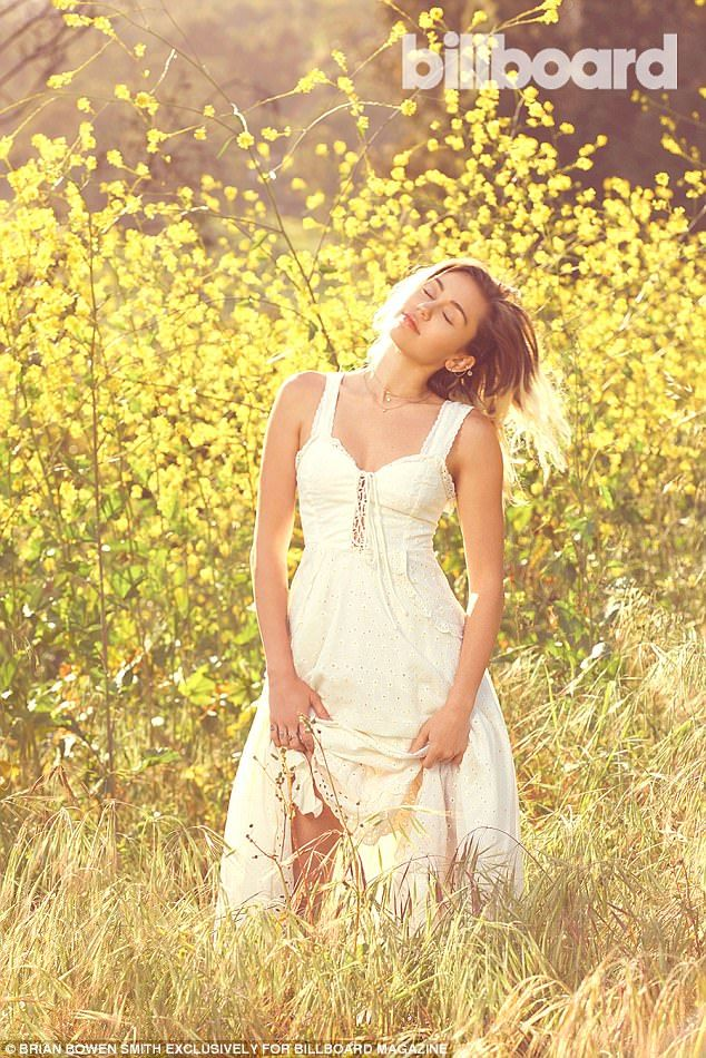 Soaking up the sun: Miley Cyrus was featured in a rather idyllic photoshoot for the lates...
