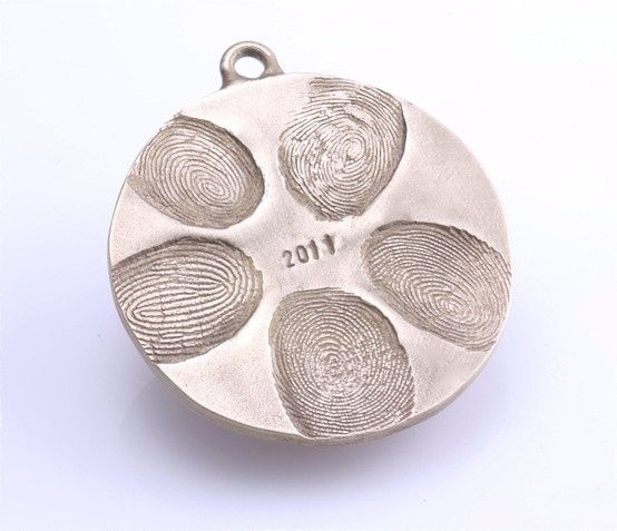 Doing this for our family ornament this year! Family Fingerprint Ornament: 2 cups flour, 1 cup salt, cold water. Mix until has consistency of play dough. Bake at 250 for 2 hours, then cool and spray with metallic paint. by ixipidor