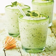 Minty Lime Frozen Mojito    1 (6-ounce) container frozen limeade concentrate  3/4 cup Key lime-flavored (or other light) rum  1/3 cup fresh mint leaves  Garnishes: fresh mint sprigs and lime slices