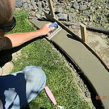 DIY Concrete Landscape Edging - this would be perfect for the path we're wanting to put in!