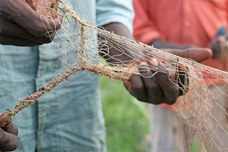 A fishermen prepare their nets in Kasenyi, DRC