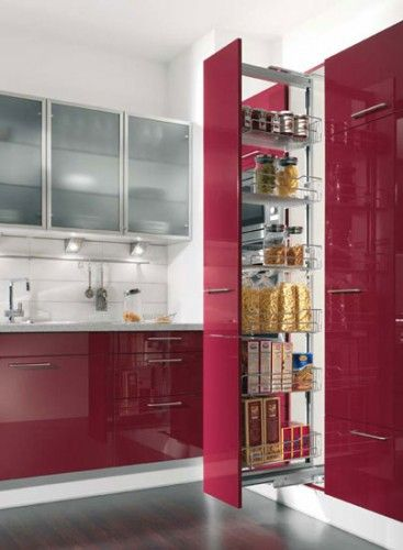 Make a statement with a tall pull-out larder in red