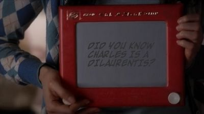 """Did you guys know Spencer won an Etch A Sketch competition in the third grade? Spencer gives a live demonstration of her mad skillz, but she's secretly conveying a message to her friends away from A's surveillance. At first, I thought Spencer was gonna make a Major! Game Changing! Revelation! …but all she wrote was """"CHARLES IS A DILAURENTIS"""".  Is that it? Um Spencer, old news? Everyone in the PLL fandom already knows which family tree Charles DiLaurentis fell out of."""
