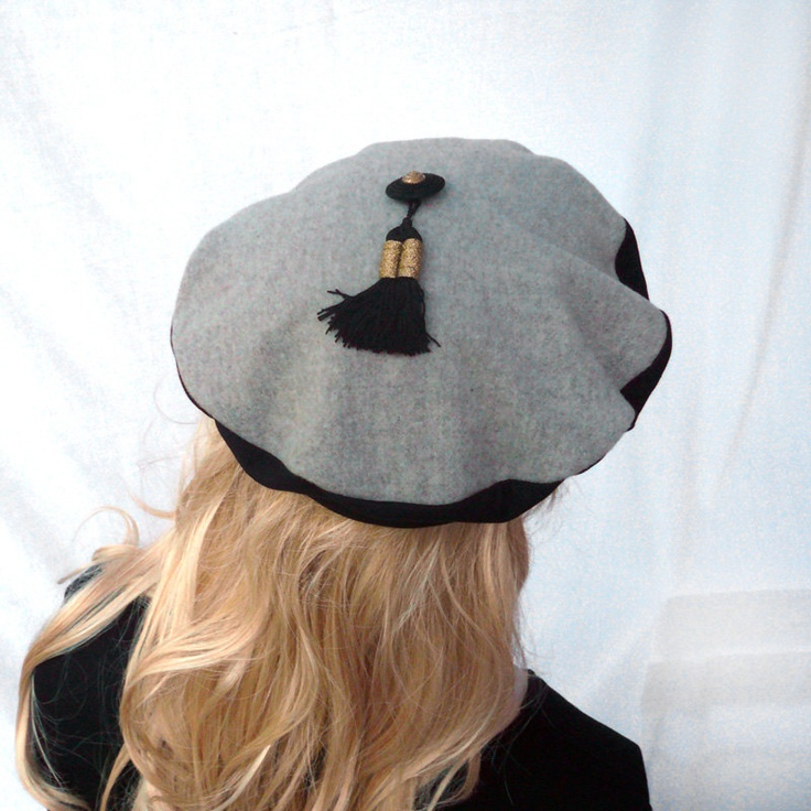Black and beige beret, top padded wool with button and tassel, gold. $36,00, via Etsy.