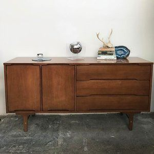lovely in so many ways mid century walnut credenza media console made by stanley has 3 drawers on the right and a cabinet on the left with cubby
