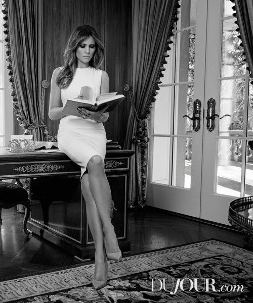 """In a contrived photo that expresses """"I read! I can read, people!""""   Lady and the Trump"""
