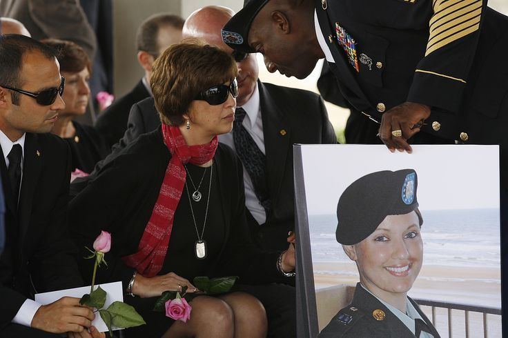 Army Sgt. Amanda Older Downing was buried Monday with 24 members of her  old Madison High School JROTC drill team in formation — one for each  year of her life.