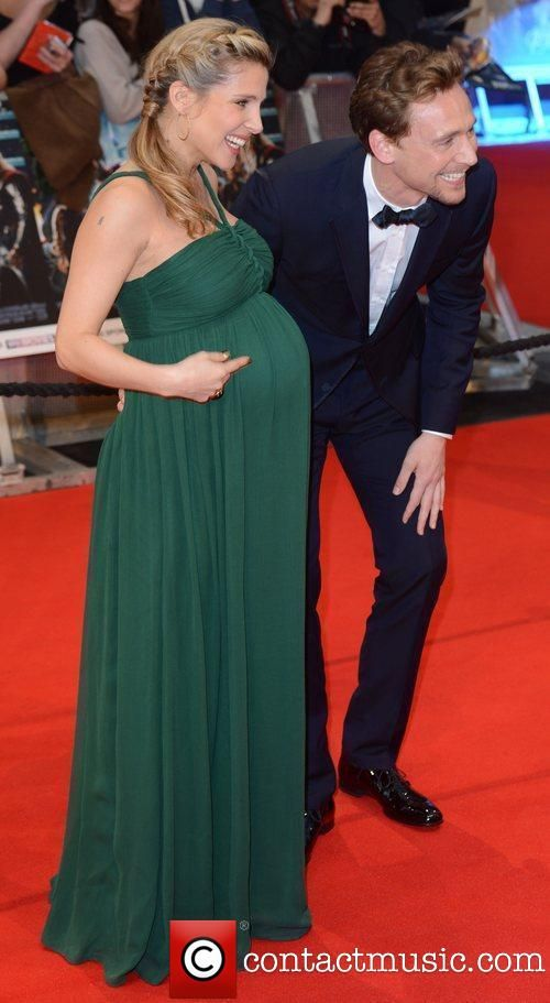 Tom Hiddleston and Chris Hemsworth's wife.... Too much adorable, and she looks gorgeous!
